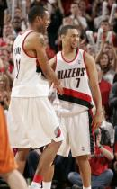 Brandon Roy has a laugh with Marcus Camby.JPG