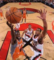 LaMarcus Aldridge challenges Jason Richardson at the goal.JPG