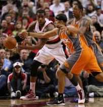 LaMarcus Aldridge is double teamed by 2 Phoenix players.JPG