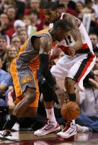 LaMarcus Aldridge tries to keep Amare Stoudamire in front of him.JPG