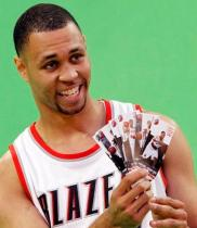 Brandon Roy holds several Blazers tickets.JPG